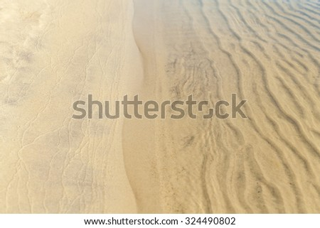 the texture of the sand in the water, river sand, coastline, beach, sandy bank of the river - stock photo