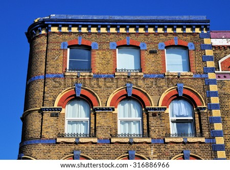 The 19th century upper facade of a Victorian period building at the Albert Embankment, London, UK. - stock photo