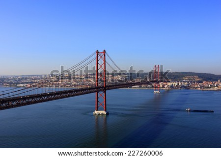 The 25th of April - 25 de Abril  suspension bridge and the Tagus or Tejo River viewed from Almada towards Lisbon.  - stock photo
