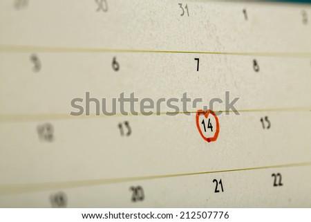 The 14th of February mark on calendar. - stock photo