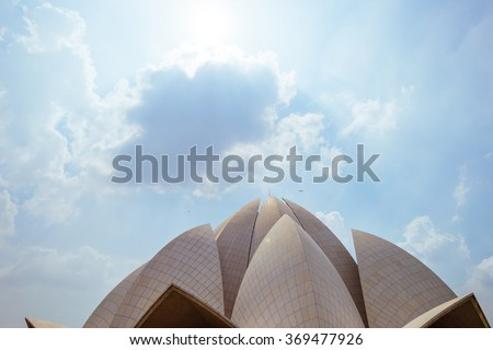 The The Bahai House (Lotus Temple) - temple for representatives of Islam, Kabbalah, Judaism, Buddhism, Hinduism, Sufism and Christianity in New Delhi, India. - stock photo
