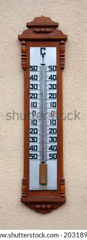 The thermometer shows the temperature in autumn - stock photo