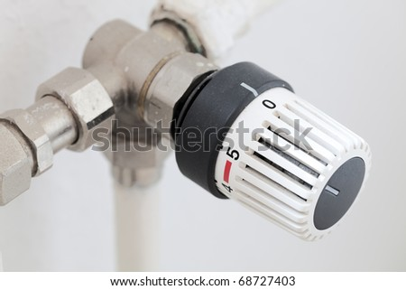 The thermostat a regulator of house heating - stock photo