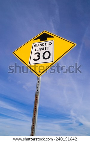 """The """"Thirty M.P.H. Ahead"""" street sign. - stock photo"""