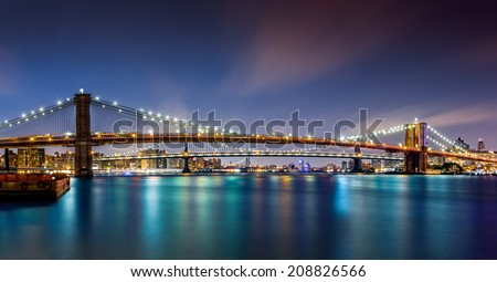 The Three Bridges: Brooklyn, Manhattan and Williamsburg bridges span across the East River between Manhattan and Brooklyn boroughs. - stock photo