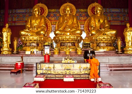 The three Chinese Buddha in the temple of Thailand. - stock photo