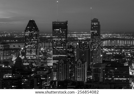 The Three Highest buildings of Montreal (At Night) in black and white,view from the mountain of Mont-Royal. - stock photo