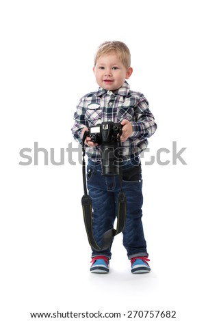The three-year boy with a camera in hand in the studio. An isolate white. - stock photo