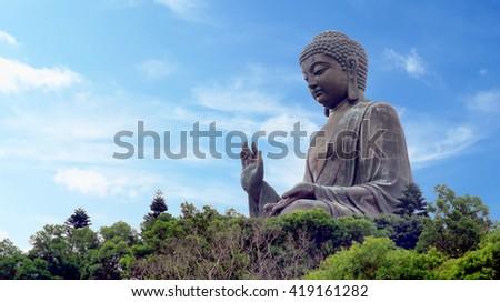 The Tian Tan Big Buddha Statue in Lantau Island in Hong Kong - stock photo