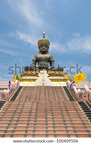 The Tian Tan Buddha in a dramatic sky background - stock photo