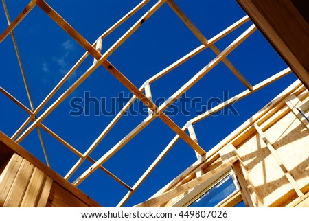 The timber frame of house under construction  - stock photo