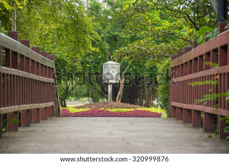 The time is now Three o'clock in the evening, Clock tower in the park - stock photo