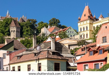 The Tin Coaters Tower from the Sighisoara citadel located in the heart of Transylvania,Romania.The tower has a very complex and strange shape and its walls are riddled with bullets and cannon balls. - stock photo