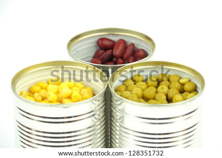 The tins with peas, red bean, corn on the white background - stock photo