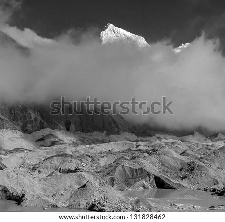 The tip of the peak Cholatse (6335 m) - Gokyo region, Nepal (black and white) - stock photo
