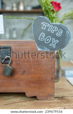 The tips box for the good service.