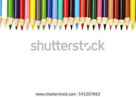 The tips of numerous colours of crayons. - stock photo