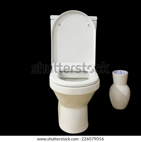 The toilet bowl and vessel for a brush isolated on the black. - stock photo