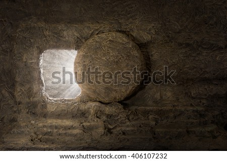 The tomb of jesus with stone rolled away and light coming from inside - stock photo