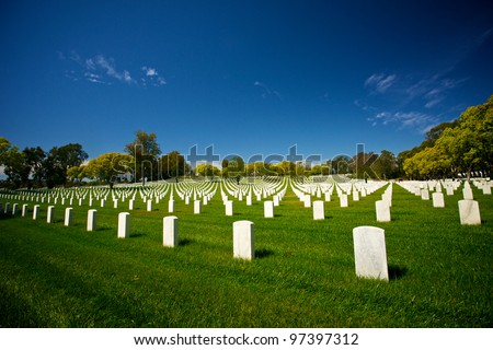 The tombstones of Las Angeles National Cemetery lay under a sun-filled summer sky.