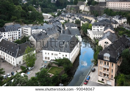 The top view on residential area of the city of Luxembourg and the river summer cloudy day