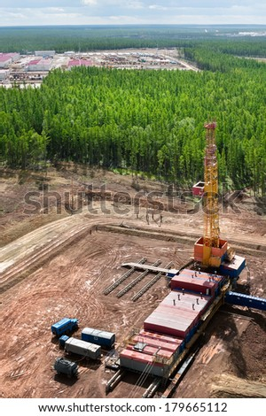 The top view on the platform cut down in the  taiga with oil chisel, Sakha (Yakutia) Republic, Eastern Siberia, Russia - stock photo