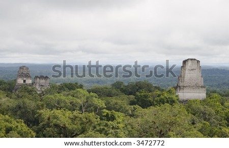 the tops of the highest pyramids in Tikal, Guatemala - stock photo