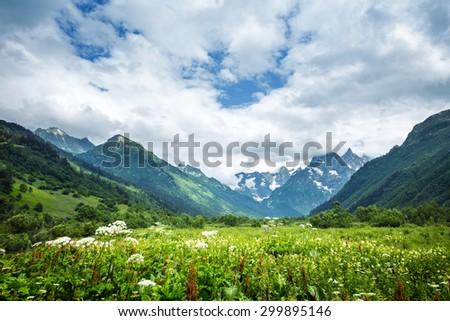 The tops of the mountains. Village Dombay, Karachay Cherkessia Republic, Russia - stock photo