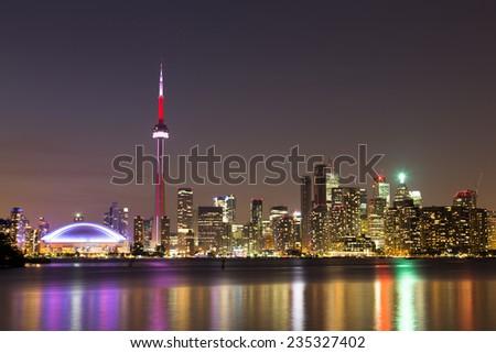 The Toronto skyline at night from Lake Ontario - stock photo
