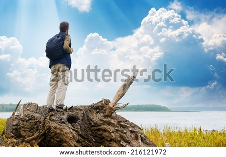 The tourist looking in a distance  on the lake - stock photo