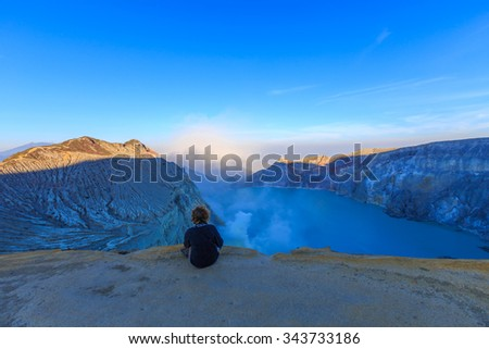 The Tourist relaxing at Kawah Ijen Volcano, East Java island, Indonesia - stock photo