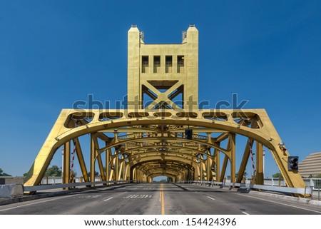The Tower Bridge (1935) is a vertical lift bridge that crosses the Sacramento River in Sacramento, California - stock photo