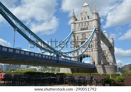 The Tower Bridge spanning over River Thames as view from the south bank in London, UK. - stock photo