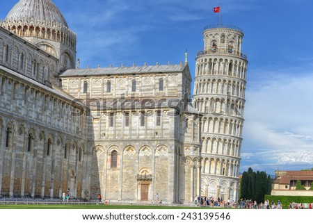 The tower of Pisa situated in Tuscany, Italy is considered to be one of the seven Wonders of the Medieval World. - stock photo