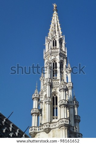 The tower of the city hall of Brussels with statues of nobles, saints and allegoric figures