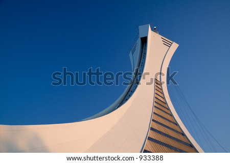 The tower of the Montreal Olympic Stadium is the tallest inclined tower in the world. Image taken at dusk. - stock photo