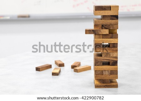The tower stack from wooden blocks toy - stock photo