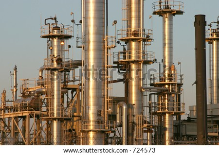 The towers and piples of an oil refinery. - stock photo