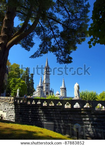 the towers of the Basilica of the Immaculate Conception in Lourds, France - stock photo