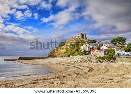 The town and castle of Criccieth, North Wales, on a bright summer day with clearing weather.