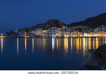 The town of Pigadia on Karpathos, Greece, at night - stock photo