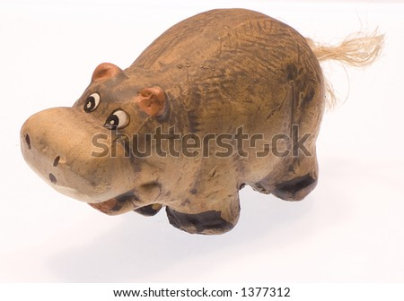 The toy clay hippopotamus. - stock photo
