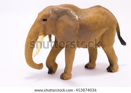 The toy elephant made of plastic on a white background