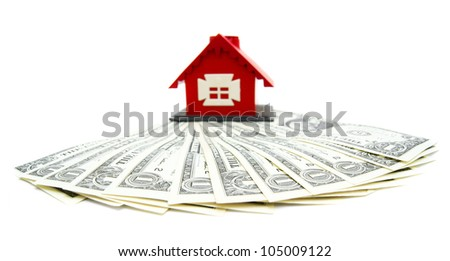 The toy house and money. On a white background. - stock photo