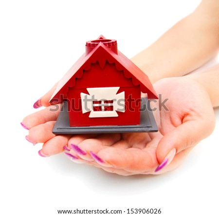The toy house in hands. On a white background. - stock photo