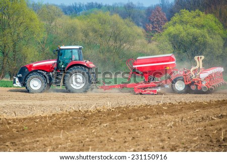 The tractor harvester working on the field - stock photo