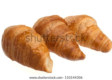 The traditional French croissants on a white background.