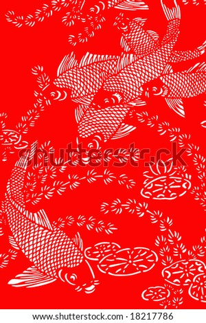 The traditional paper-cut fish on the red - stock photo
