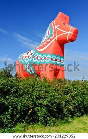 The traditional wooden Dalecarlian Horse symbol of Swedish Dalarna province and Sweden in general - stock photo