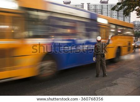 The traffic policeman commanding traffic - stock photo
